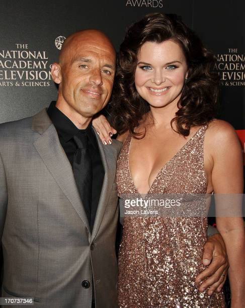 Actress Heather Tom and husband James Achor attend the 40th annual Daytime Emmy Awards at The Beverly Hilton Hotel on June 16 2013 in Beverly Hills...