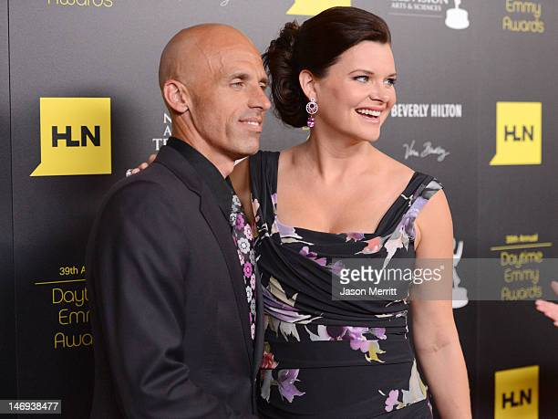 Actress Heather Tom and James Achor arrives at The 39th Annual Daytime Emmy Awards broadcasted on HLN held at The Beverly Hilton Hotel on June 23...