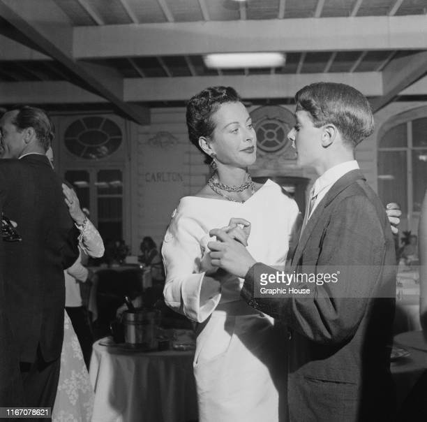 Actress Hedy Lamarr dancing with a teenage boy at a party at the Carlton Hotel in Cannes, France, circa 1955.