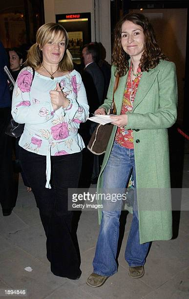 Actress Helen Baxendale accompanied by unidentified friend leaves the Playhouse theater after a performance of Three Sisters April 3 2003 in London...
