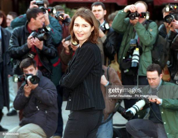 Actress Helen Baxendale is surrounded by photographers at a photocall in London's Leicester Square today following her return from America where she...