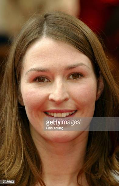 Actress Helen Baxendale smiles for photographers April 21 2002 as she arrives at the British Academy Television Awards in the Theatre Royal London