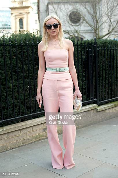 Actress Helen George wears a Kristina Fidelskaya top and trousers Porsum sunglasses and Skinny Dip bag on day 1 during London Fashion Week...