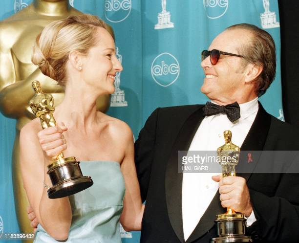 Actress Helen Hunt and actor Jack Nicholson look at each other after winning Best Actress and Best Actor Oscars for their roles in As Good As It Gets...