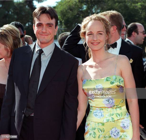 Actress Helen Hunt arrives with her companion actor Hank Azaria for the 50th Annual Primetime Emmy Awards 13 September at the Shrine Auditorium in...