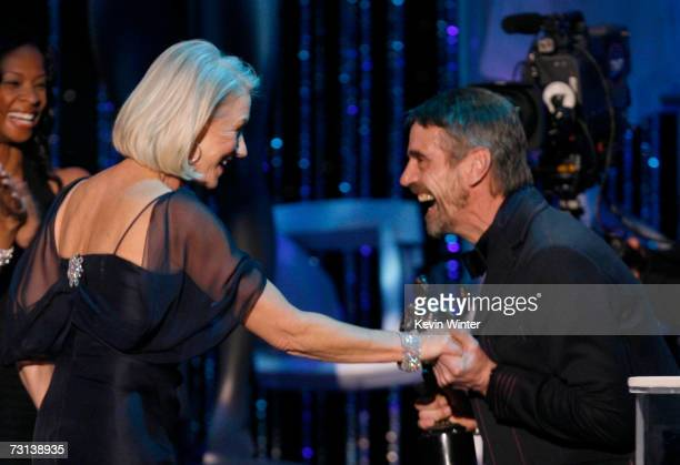 Actress Helen Mirren accepts her Oustanding Female Actor in a Motion Picture award for The Queen from actor Jeremy Irons onstage at the 13th Annual...