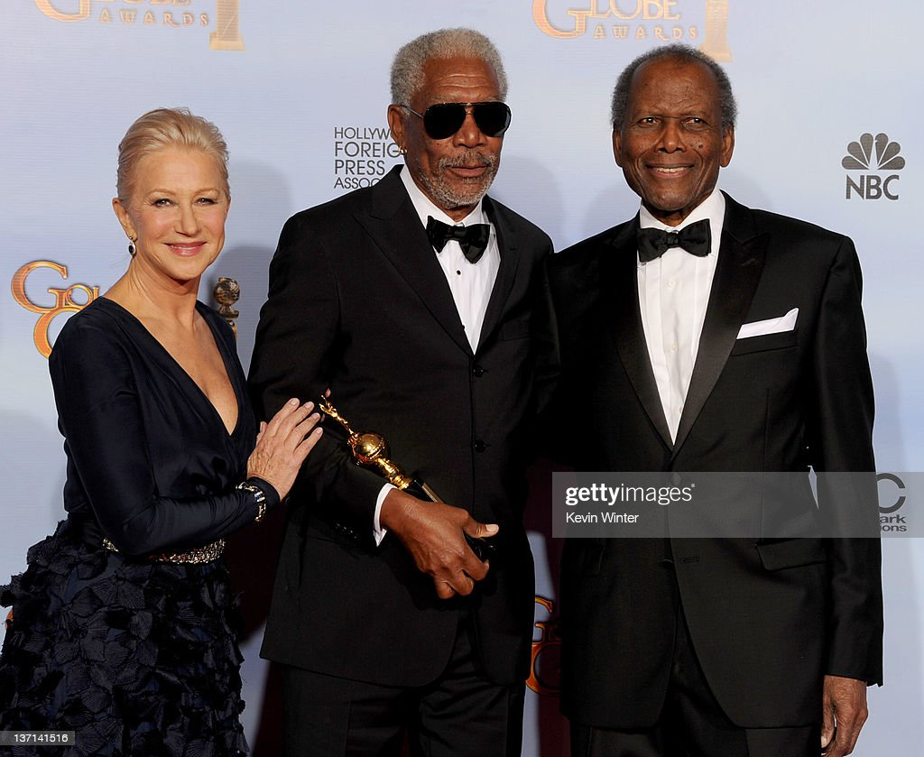 Actress Helen Mirren, actors Morgan Freeman, and Sidney Poitier pose in the press room with the Cecil B. DeMille Golden Globe award for career achievement at the 69th Annual Golden Globe Awards held at the Beverly Hilton Hotel on January 15, 2012 in Beverly Hills, California.