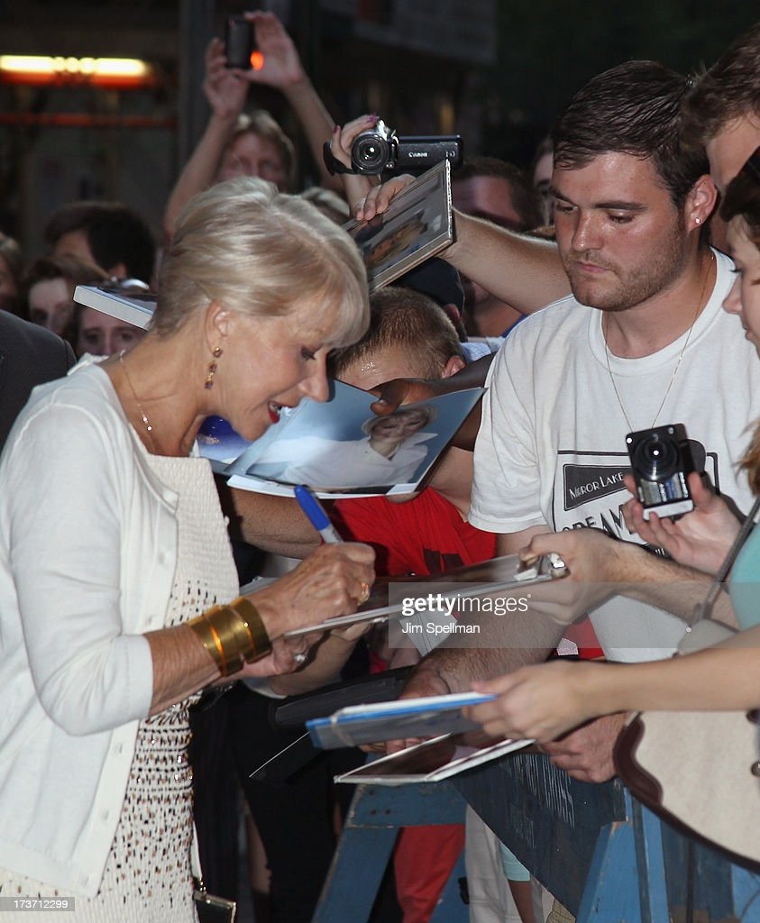 Actress Helen Mirren and fans attends The Cinema Society & Bally screening of Summit Entertainment's 'Red 2' at the Museum of Modern Art on July 16, 2013 in New York City.