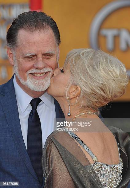 Actress Helen Mirren kisses her husband as they arrive at the 16th annual Screen Actors Guild Awards at the Shrine Exposition Center in Los Angeles...