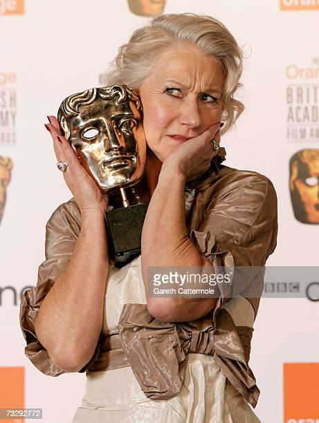 Actress Helen Mirren poses backstage in the Awards Room with The Actress in a Leading Role Award for 'The Queen' at The Orange British Academy Film...
