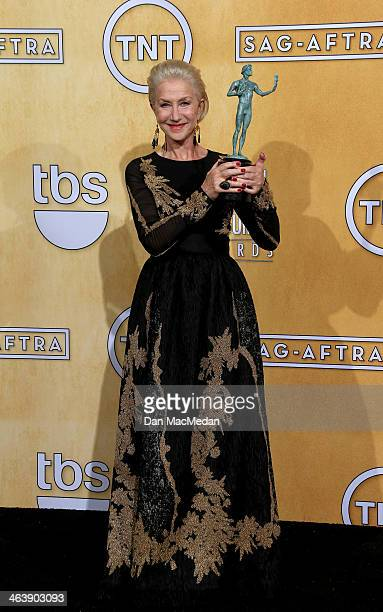 Actress Helen Mirren poses in the press room with the award for Outstanding Performance by a Female Actor in a Miniseries or Television Movie for...