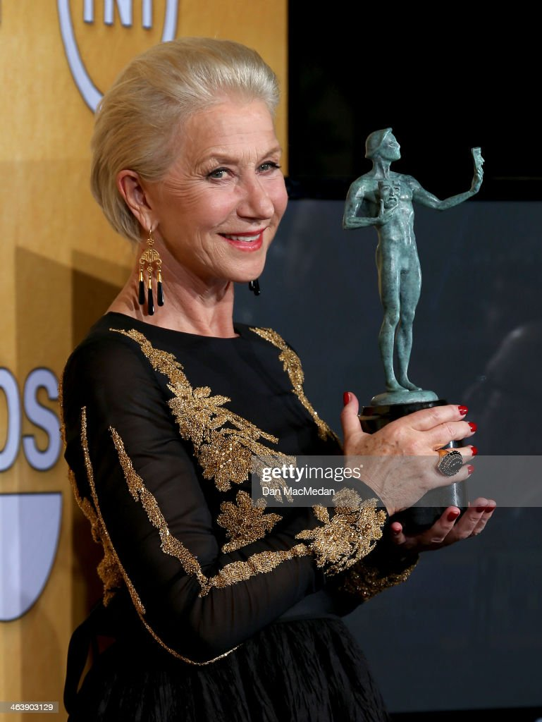 Actress Helen Mirren poses in the press room with the award for Outstanding Performance by a Female Actor in a Miniseries or Television Movie for 'Phil Spector' at the 20th Annual Screen Actors Guild Awards at the Shrine Auditorium on January 18, 2014 in Los Angeles, California.