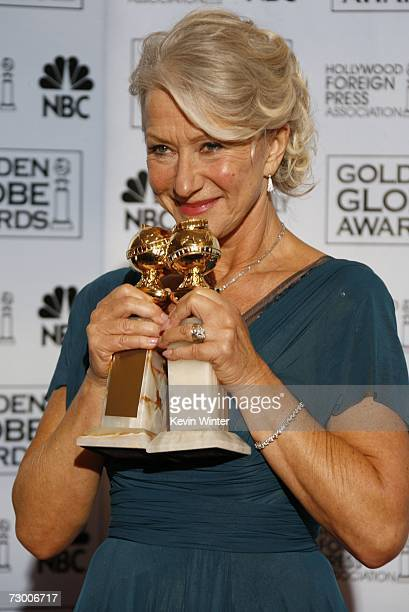 Actress Helen Mirren poses with her Best Performance by an Actress in a Motion Picture Drama award for The Queen and Best Performance by an Actress...