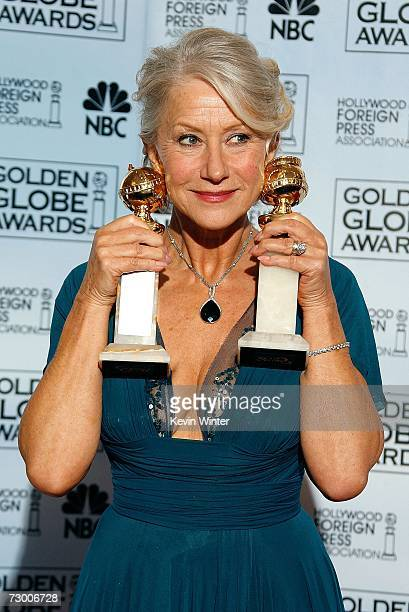 "Actress Helen Mirren poses with her Best Performance by an Actress in a Motion Picture - Drama award for ""The Queen"" and Best Performance by an..."