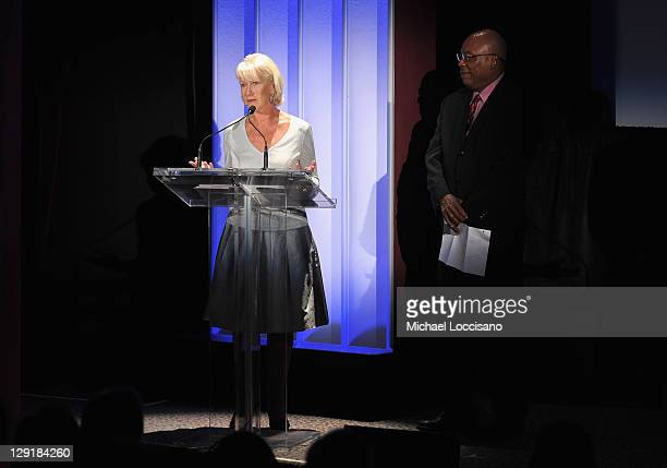 Actress Helen Mirren presents as First Vice President of the Directors Guild of America looks on at the 2011 Directors Guild Of America Honors at the...
