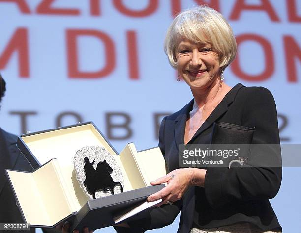 Actress Helen Mirren receives the 'Silver Marc'Aurelio Jury Award' for Best Actress for 'The Last Station' as she attends the Official Awards...