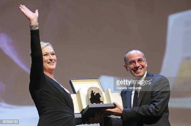 Actress Helen Mirren receives the 'Silver Marc'Aurelio Jury Award' for Best Actress for 'The Last Station' from director Giuseppe Tornatore as she...