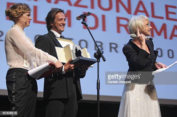 Actress Helen Mirren receives the 'Silver Marc'Aurelio Jury Award' for Best Actress for 'The Last Station' from member of Jury Gabriele Muccinio and...