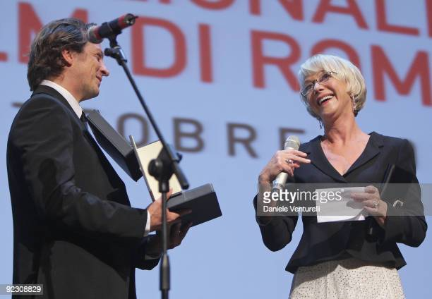 Actress Helen Mirren receives the 'Silver Marc'Aurelio Jury Award' for Best Actress for 'The Last Station' from member of Jury Gabriele Muccinio as...