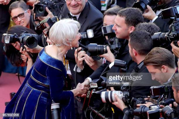 Actress Helen Mirren speaks with photographer Dave Fisher as she attends the screening of 'Girls Of The Sun ' during the 71st annual Cannes Film...