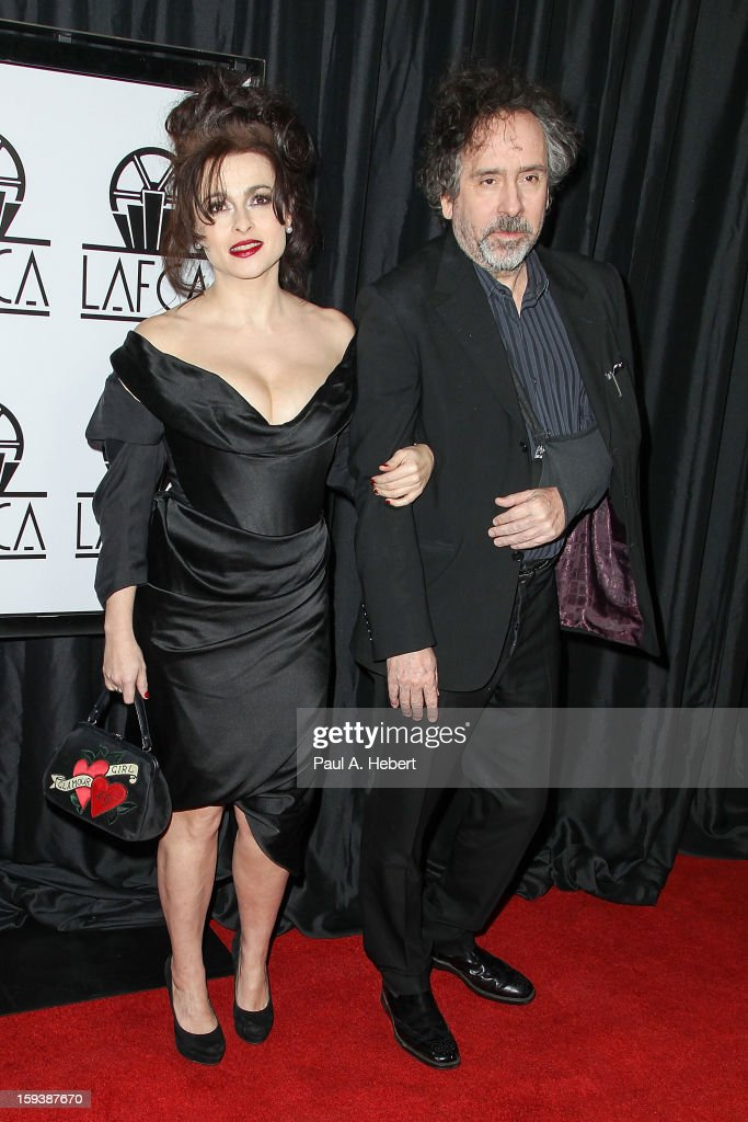Actress Helena Bonham Carter and director Tim Burton arrive at the 38th Annual Los Angeles Film Critics Association Awards held at the InterContinental Hotel on January 12, 2013 in Century City, California.