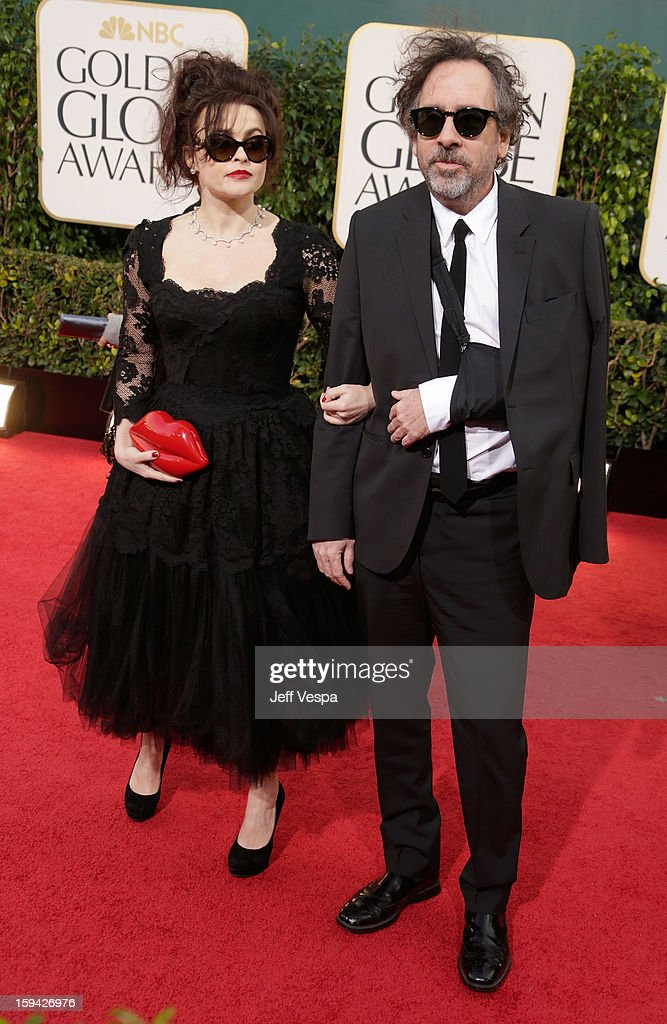 Actress Helena Bonham Carter and director Tim Burton arrive at the 70th Annual Golden Globe Awards held at The Beverly Hilton Hotel on January 13, 2013 in Beverly Hills, California.