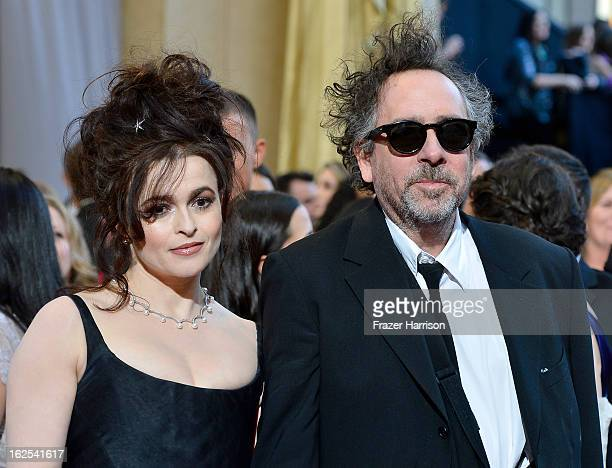 Actress Helena Bonham Carter and director Tim Burton arrive at the Oscars at Hollywood Highland Center on February 24 2013 in Hollywood California