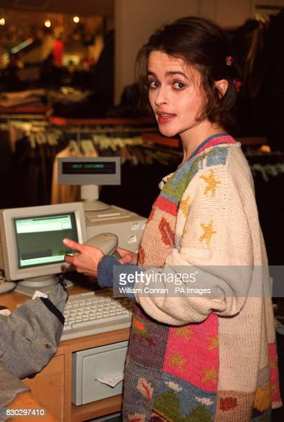 Actress Helena BonhamCarter serving Christmas shoppers at Selfridges in London for the celebrity party night dedicated to raising money for the...