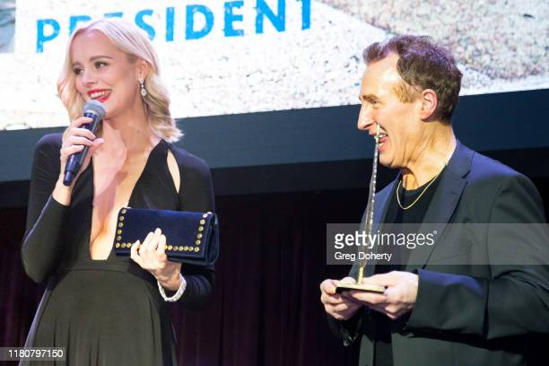 Actress Helena Mattsson presents an award to John Jay A Faber at the Charmaine Blake Presents The Faber Ryan Youth Foundation Gala at Live House...