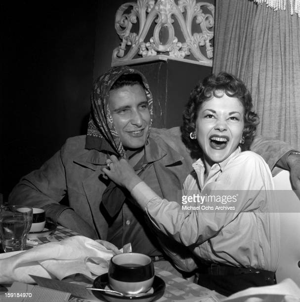 Actress Helene Stanley hams it up with LA gangster Johnny Stompanato at Ciro's nightclub on May 24 1954 in Los Angeles California