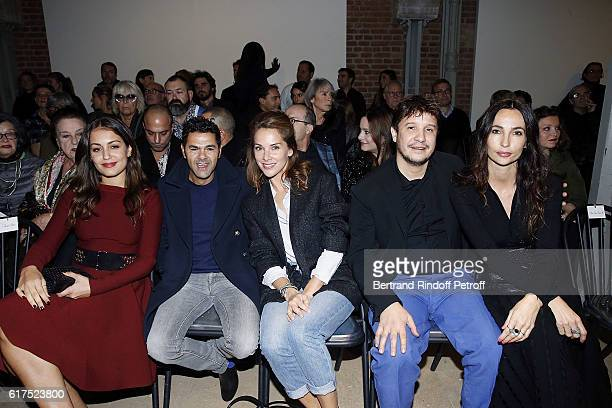 Actress Hiba Abouk Jamel Debbouze Melissa Theuriau Artist Adel Abdessemed and his wife Julia Abdessemed attend the Azzedine Alaia Fashion Show at...