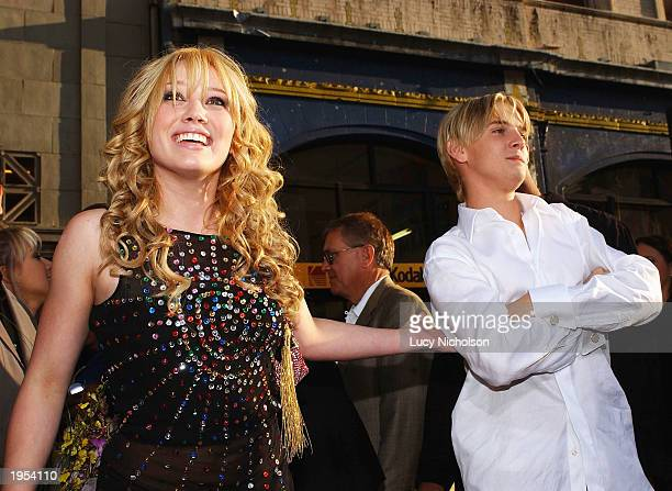 Actress Hilary Duff and singer Aaron Carter attend the premiere of The Lizzie McGuire Movie on April 26 2003 in Hollywood California