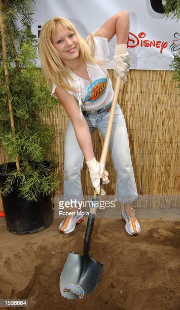 Actress Hilary Duff of Dinsey's Lizzie McGuire volunteers to refurbish the grounds at the Boys and Girls Club of Burbank April 27 2002 in Burbank CA
