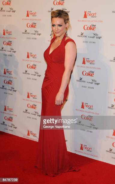 Actress Hilary Duff wearing Donna Karan poses at The Heart Truth's Red Dress Collection at The Tent in Bryant Park on February 13 2009 in New York...