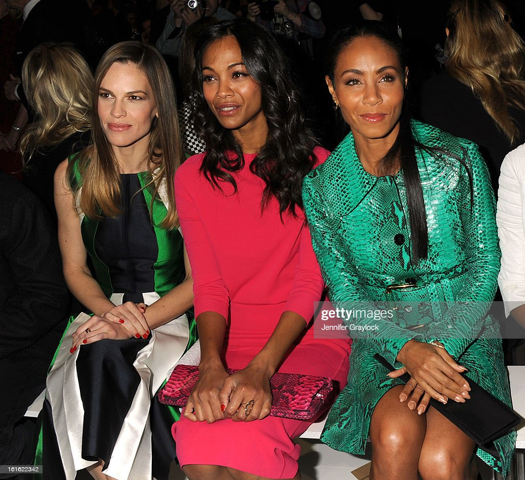 Actress Hilary Swank, Actress Zoe Saldana and Actress Jada Pinkett Smith front row during the Michael Kors Fall 2013 Mercedes-Benz Fashion Show at The Theater at Lincoln Center on February 13, 2013 in New York City.