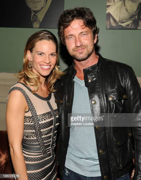 Actress Hilary Swank and actor Gerard Butler attend the Cinema Society Laura Mercier host the after party for Conviction at Soho Grand Hotel on...