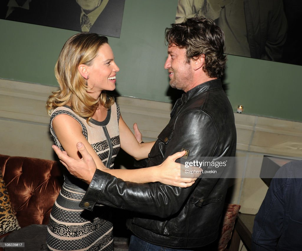 Actress Hilary Swank and actor Gerard Butler attend the Cinema Society & Laura Mercier host the after party for 'Conviction' at Soho Grand Hotel on October 12, 2010 in New York City.