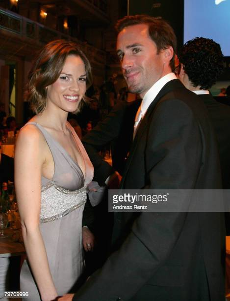 Actress Hilary Swank and actor Joseph Fiennes attend the 7th Annual Cinema For Peace Gala sponsored by BMW CleanEnergy part of the 58th Berlinale...