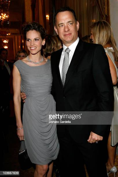 Actress Hilary Swank and actor Tom Hanks attend the Saks Fifth Avenue's Unforgettable Evening cocktail reception benefiting Entertainment Industry...