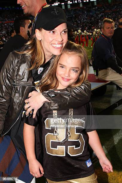Actress Hilary Swank and Charlotte Connick attend Super Bowl XLIV at Sun Life Stadium on February 7 2010 in Miami Gardens Florida