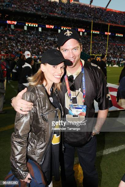 Actress Hilary Swank and musician Harry Connick Jr attend Super Bowl XLIV at Sun Life Stadium on February 7 2010 in Miami Gardens Florida