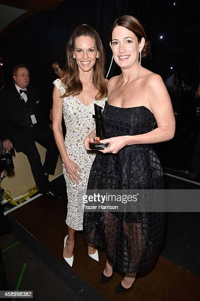 Actress Hilary Swank and Writer Gillian Flynn backstage at the 18th Annual Hollywood Film Awards at The Palladium on November 14 2014 in Hollywood...