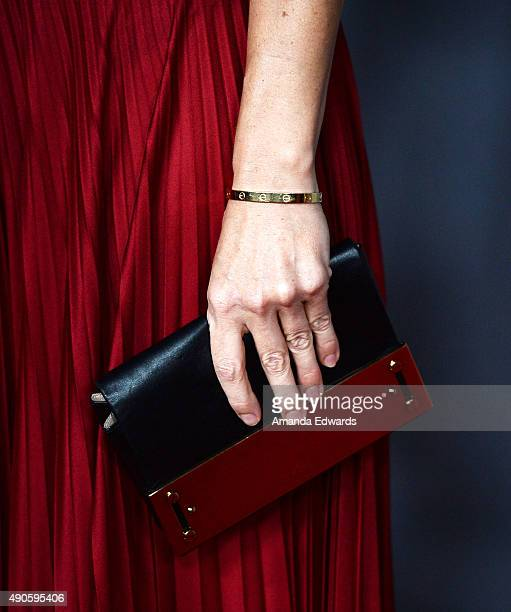 Actress Hilary Swank clutch and bracelet detail arrives at The Los Angeles Philharmonic 2015/2016 Season Opening Night Gala at the Walt Disney...