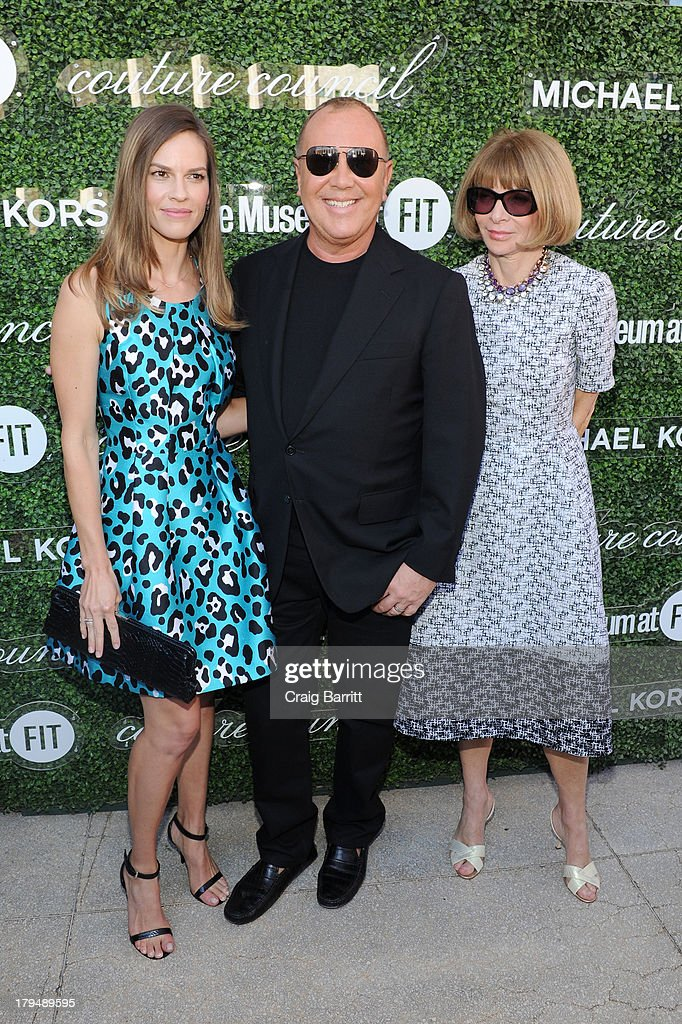 Actress Hilary Swank, designer Michael Kors, and Vogue Editor-in-Chief Anna Wintour attend The Couture Council of The Museum at the Fashion Institute of Technology hosted luncheon honoring Michael Kors with the 2013 Couture Council Award on September 4, 2013 in New York City.