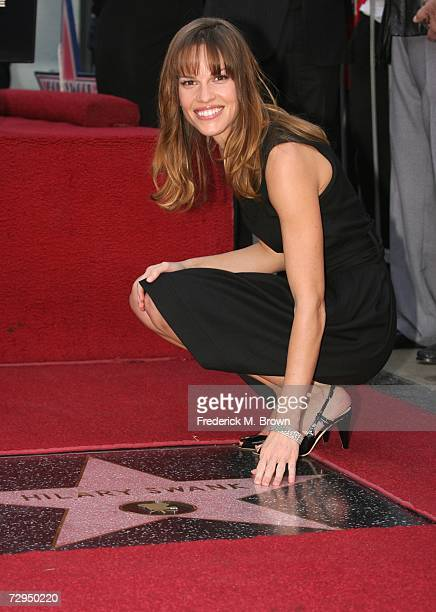 Actress Hilary Swank poses for photographers on the Hollywood Walk of Fame at Grauman's Chinese Theatre on January 8, 2007 in Hollywood, California.