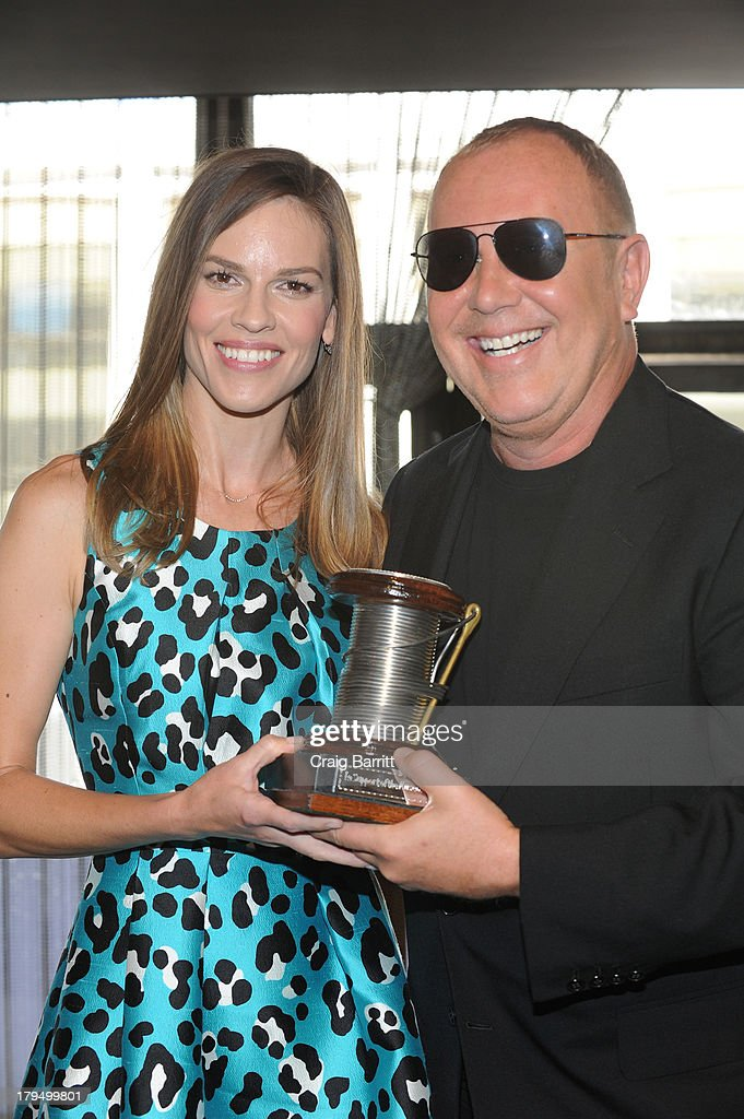 Actress Hilary Swank (L) poses with designer Michael Kors at The Couture Council of The Museum at the Fashion Institute of Technology hosted luncheon honoring Michael Kors with the 2013 Couture Council Award on September 4, 2013 in New York City.