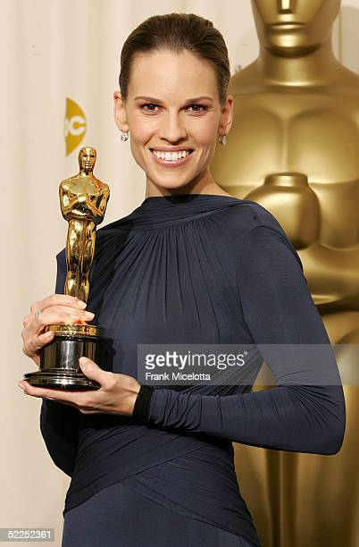 Actress Hilary Swank poses with her 'Best Actress in a Leading Role' award for 'Million Dollar Baby' backstage during the 77th Annual Academy Awards...