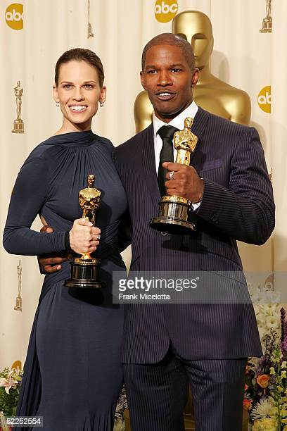 "Actress Hilary Swank poses with her ""Best Actress in a Leading Role"" award for ""Million Dollar Baby"" with actor Jamie Foxx and his award for ""Best..."