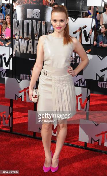 Actress Holland Roden arrives at the 2014 MTV Movie Awards at Nokia Theatre LA Live on April 13 2014 in Los Angeles California