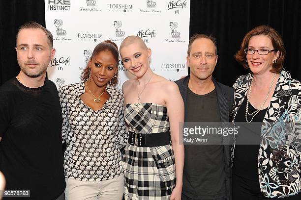 Actress Holly Robinson celebrity trainer Ashley Conrad and her mother Gail conrad pose for a picture with designers Steven Cox and Daniel Silver as...